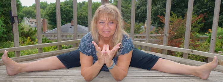 Tara Cindy Sherman demonstrates dragonfly pose and lotus mudra.